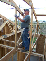 Worker working on joists